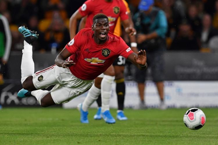 Paul Pogba sofreu ataques racistas após perder pênalti no Campeonato Inglês - Foto: Paul Ellis | AFP