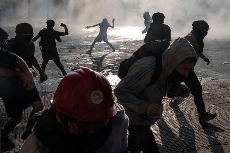 Greve no Chile completa uma semana - Foto: Pedro Ugarte | AFP