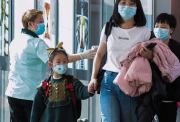 Coronavírus já matou 26 pessoas; OMS mantém alerta permanente | AFP