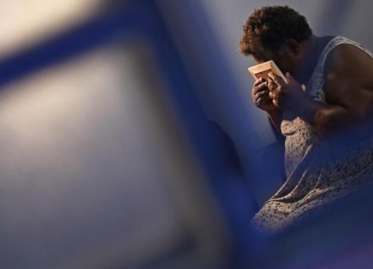 Um ano após tragédia, as lágrimas ainda rolam em Brumadinho | Douglas Magno | AFP
