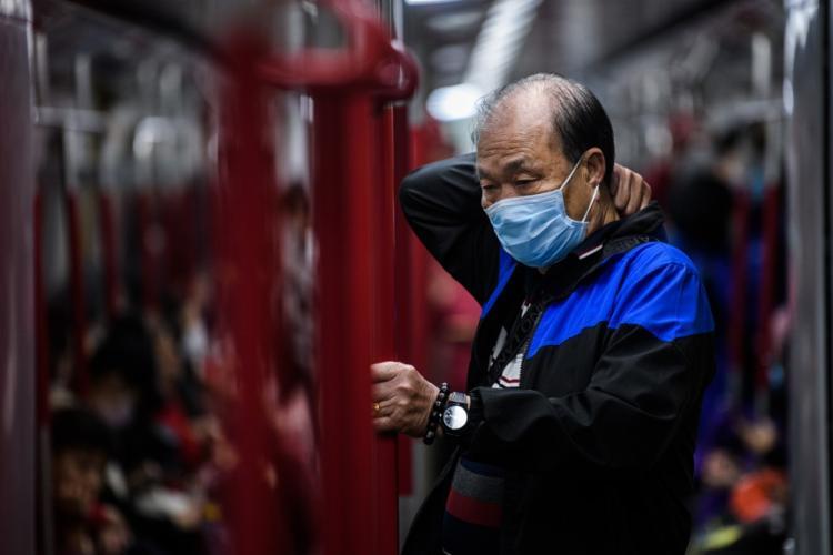 Paciente teve contato com uma chinesa que estava em visita à Alemanha | Foto: Anthony Wallace | AFP - Foto: Anthony Wallace | AFP