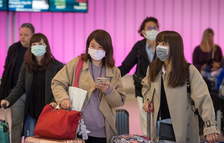 Chineses usam máscaras para evitar a contaminação | Foto: Mark RALSTON | AFP - Foto: Mark RALSTON | AFP