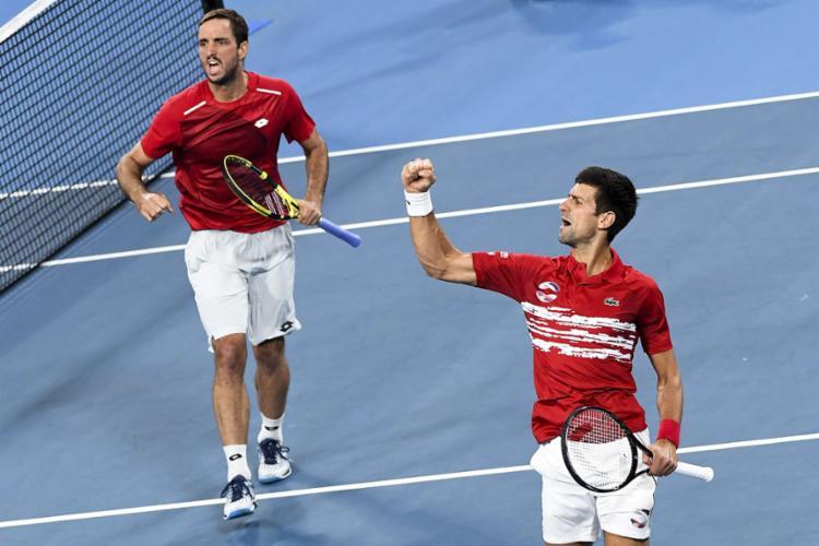 Djokovic se juntou a Viktor Troicki e comemorou mais uma vitória neste domingo | Foto: William West | AFp - Foto: William West | AFP