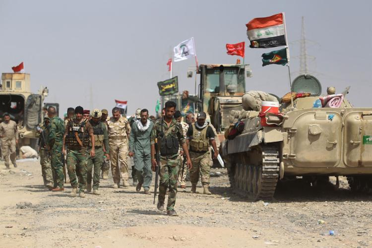 Em setembro de 2017, as forças iraquianas e unidades de mobilização popular avançaram em direção à fortaleza de Hawija, do grupo Estado Islâmico (IS), para recuperar a cidade dos jihadistas | Foto: Ahmad Al-Rubaye | AFP - Foto: Ahmad Al-Rubaye | AFP