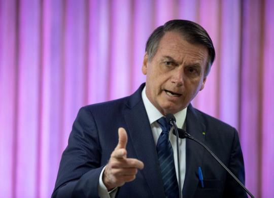 Bolsonaro vai pedir perícia independente da morte de Adriano Nóbrega | Mauro Pimentel | AFP