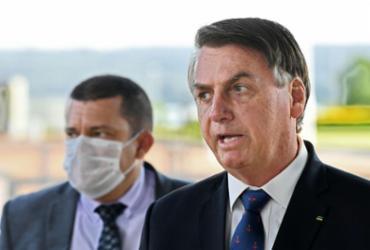 Presidente Bolsonaro sanciona MP da renda básica emergencial | Evaristo Sa | AFP