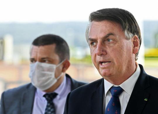 Presidente Bolsonaro sanciona MP da renda básica emergencial   Evaristo Sa   AFP