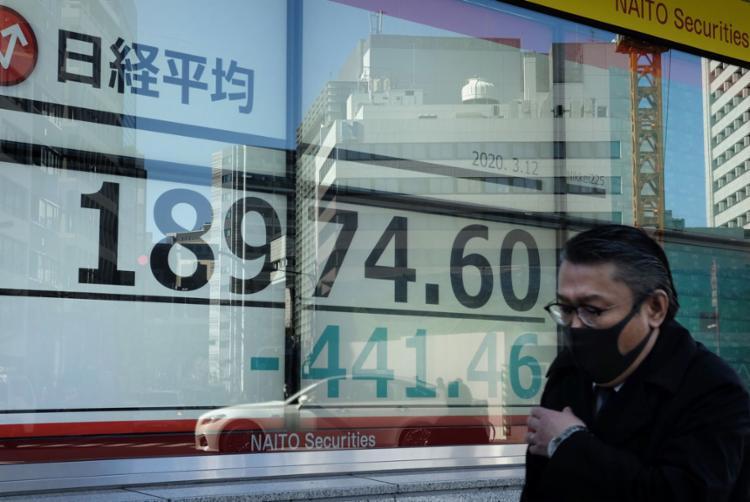 É prematuro dizer que o novo coronavírus vai causar uma recessão no mundo | Foto: Kazuhiro Nogi | AFP - Foto: Kazuhiro Nogi | AFP