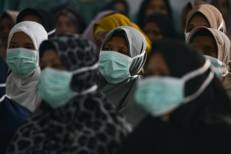 No total, 2.336 pessoas foram infectadas desde o surgimento da doença no Irã | Foto: Chaideer Mahyuddin | AFP - Foto: Chaideer Mahyuddin | AFP