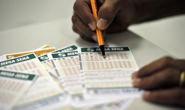 No primeiro sorteio, realizado na terça-feira, 10, nenhuma aposta acertou as seis dezenas | Foto: Marcello Casal Jr. | Agência Brasil - Foto: Marcello Casal Jr. | Agência Brasil