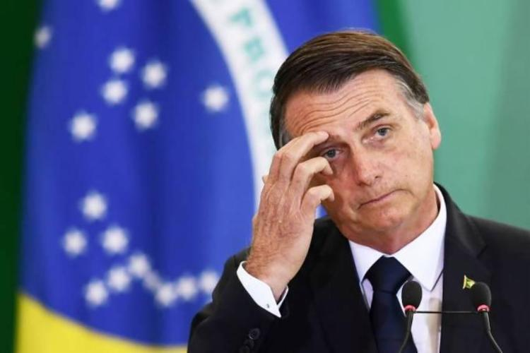 """Bolsonaro responsabilizou """"infiltrados"""" por gritos de volta do AI-5   Foto: Evaristo Sá   AFP - Foto: Evaristo Sá   AFP"""