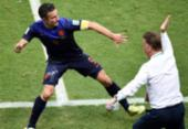 Van Persie diz que levou tapa na cara de treinador durante jogo da Copa na Fonte Nova | Foto: Dimitar Dilkoff | AFP