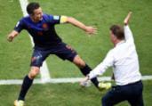 Van Persie diz que levou tapa na cara na Fonte Nova | Dimitar Dilkoff | AFP
