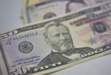 Dólar fecha no menor nível em dez semanas e cai para R$ 5,08 |