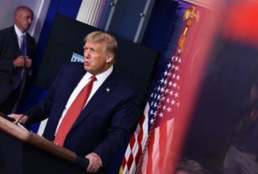 Agentes atiram em suspeito e Trump é escoltado na Casa Branca | Brendan Smialowski | AFP