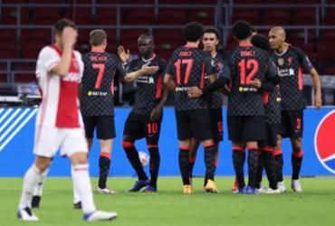 Fora de casa, Liverpool vence Ajax pela Liga dos Campeões | Kenzo Tribouillard | AFP