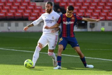 Real Madrid vence Barcelona por 3 a 1 pelo Espanhol | Lluis Gene | AFP