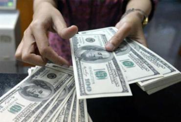 Dólar cai para menor valor em quatro meses com euforia externa |