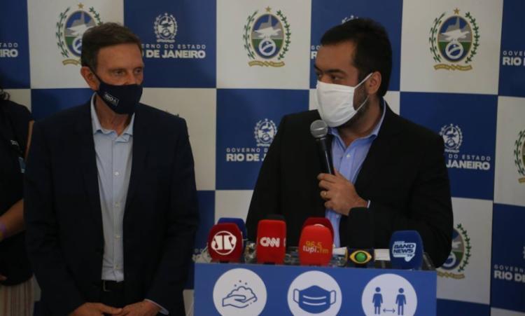 Medida foi anunciada nesta tarde em coletiva de imprensa com o prefeito Marcelo Crivella e o governador em exercício Claudio Castro I Foto: O Globo - Foto: O Globo