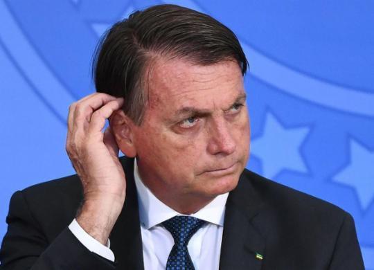 Bolsonaro confirma adiamento e diz que avaião parte para Índia em até três dias | Evaristo Sa | AFP