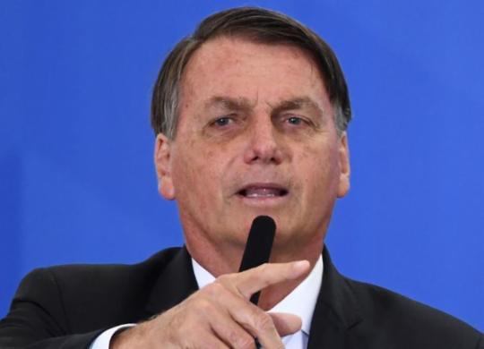 Bolsonaro faz reunião com deputados para 'influir' em eleição para comando da Câmara | Evaristo Sa | AFP