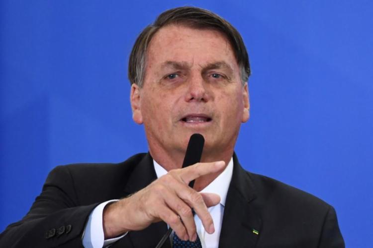 Presidente se reuniu com parlamentares do PSL e outros apoiadores para angariar votos para Arthur Lira (PP-AL) - Foto: Evaristo Sa | AFP