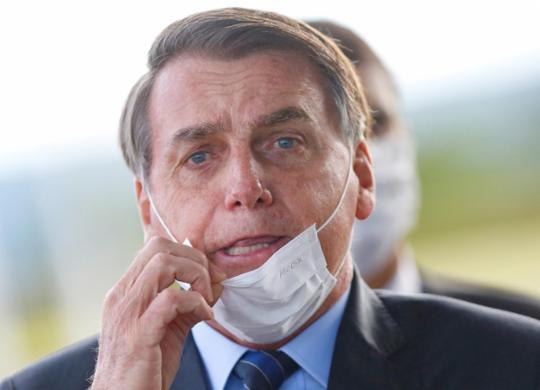 Bolsonaro critica novas medidas contra Covid-19 e provoca aglomerações em inauguração no Ceará   Reprodução 