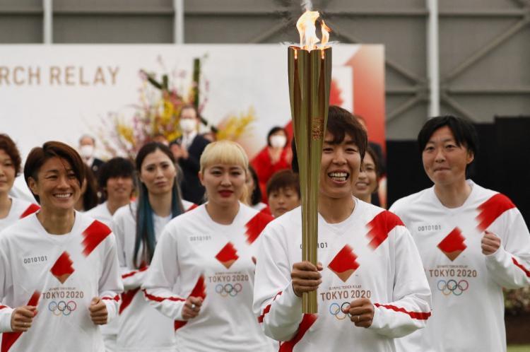 Tocha tem formato de flor de cerejeira | Foto: Kim Kyung-Hoon | AFP - Foto: Kim Kyung-Hoon | AFP