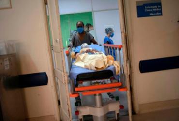 Brasil registra 210 óbitos e 14,4 mil infecções por Covid-19 em 24h | Mauro Pimentel | AFP