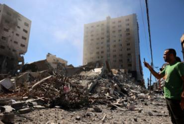 Israel destrói escritórios internacionais de imprensa em Gaza | Mohammed ABED / AFP