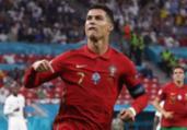 Portugal e França empatam em 2 a 2 com recorde de CR7 | Bernadett Szabo | AFP