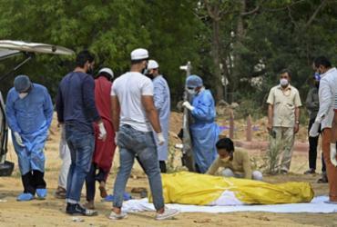 Número de vítimas da Covid-19 na Índia pode ser de 5 a 10 vezes maior | Sajjad Hussain | AFP
