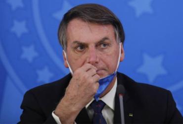 Sem mencionar meio milhão de mortos em vídeo, Bolsonaro deseja sorte aos policiais do caso Lázaro | AFP