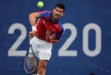 Djokovic e Medvedev vão para as quartas de final em Tóquio | Giuseppe Cacace | AFP