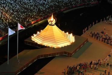 Chama olímpica já ilumina em Tóquio os 'Jogos da Pandemia' | François-Xavier Marit | AFP