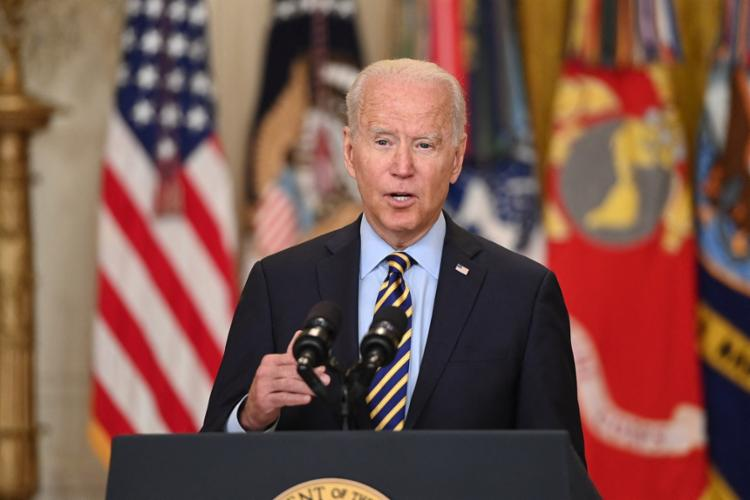 Biden pediu que os países da região ajudem a trazer algum tipo de acordo político entre as partes antagônicas | Foto: Saul Loeb | AFP - Foto: Saul Loeb | AFP