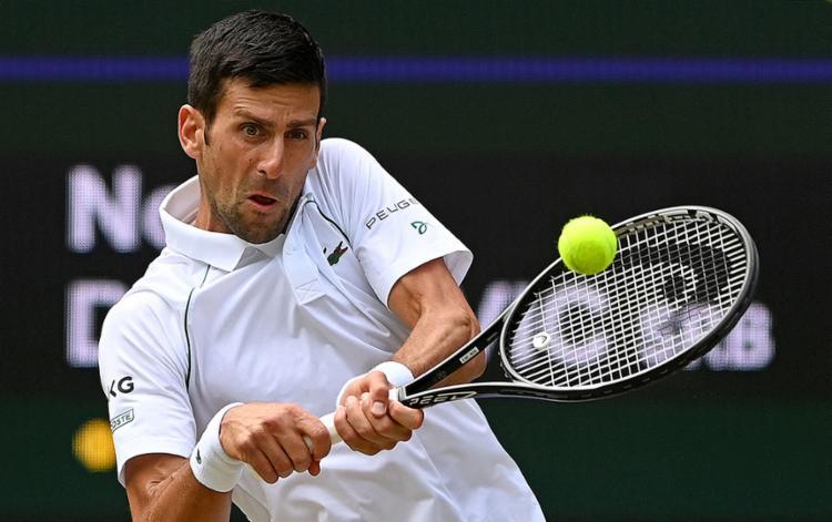 O tenista número um do mundo vai em busca da medalha de ouro inédita   Foto: Glyn Kirk   AFP - Foto: Glyn Kirk   AFP