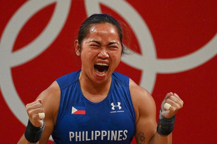 A filipina terminou a competição com 224 pontos (97 kg do arranque e 127 kg do arremesso) | Foto: Vincenzo Pinto | AFP - Foto: Vincenzo Pinto | AFP