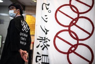 Clima olímpico e medalhas não aplacam raiva dos japoneses | Philip Fong | AFP