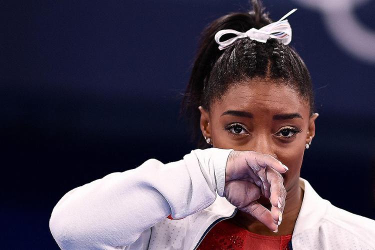Biles, de 24 anos, surpreendeu a todos nas Olimpíadas do mês passado após se retirar da final por equipes e, posteriormente, do individual geral | Foto: Loic Venance | AFP - Foto: Loic Venance | AFP