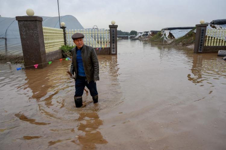 Região recebeu três vezes a média mensal de chuvas em uma semana   STR   AFP - Foto: STR   AFP